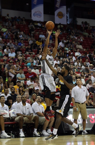 Jul 14, 2013; Las Vegas, NV, USA; Portland Trailblazers guard CJ McCollum takes a three point shot over the defending Los Angeles Laker forward Elias Harris during an NBA Summer League game at the Thomas and Mack Center. Mandatory Credit: Stephen R. Sylvanie-USA TODAY Sports