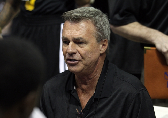 Jul 14, 2013; Las Vegas, NV, USA; Los Angeles Lakers head coach Dan Dantoni speaks to one of his players during a time out from play against the Portland Trailblazers in an NBA Summer League game at the Thomas and Mack Center. Mandatory Credit: Stephen R. Sylvanie-USA TODAY Sports