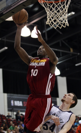 Jul 14, 2013; Las Vegas, NV, USA; Cleveland Cavaliers forward Carrick Felix goes for a layup as Memphis Grizzlies forward Matt Howard defends during an NBA Summer League game at Cox Pavillion. Cleveland won the game 69-58. Mandatory Credit: Stephen R. Sylvanie-USA TODAY Sports