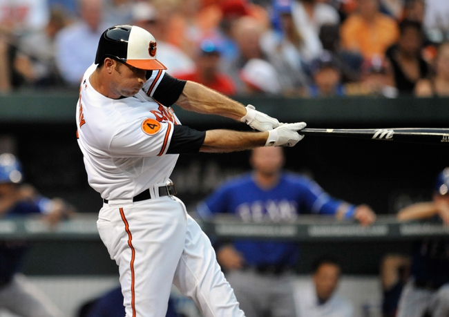 Jul 10, 2013; Baltimore, MD, USA; Baltimore Orioles shortstop J.J. Hardy (2) bats in the second inning against the Texas Rangers at Oriole Park at Camden Yards. The Orioles defeated the Rangers 6-1. Mandatory Credit: Joy R. Absalon-USA TODAY Sports