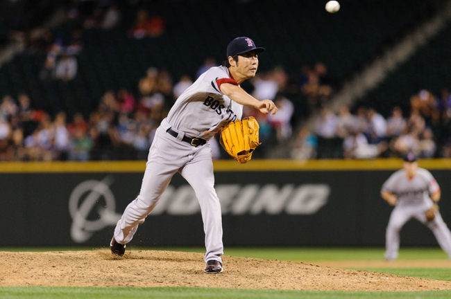 Jul 9, 2013; Seattle, WA, USA; Boston Red Sox relief pitcher Koji Uehara (19) pitches to the Seattle Mariners during the game at Safeco Field. Boston defeated Seattle 11-8. Mandatory Credit: Steven Bisig-USA TODAY Sports