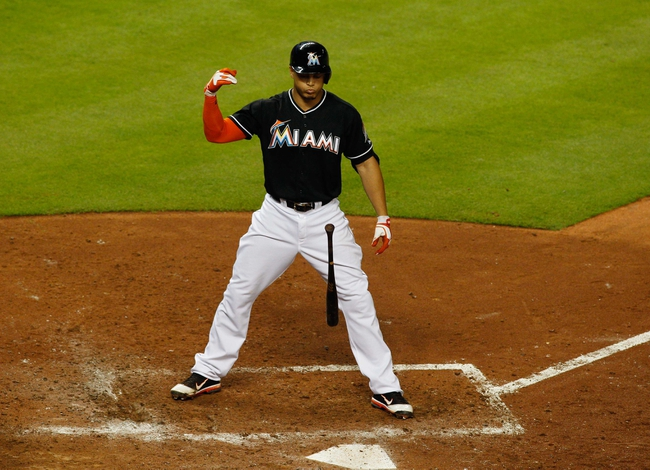 Jul 12, 2013; Miami, FL, USA; Miami Marlins right fielder Giancarlo Stanton (27) flips his bat after striking out against the Washington Nationals in the sixth inning at Marlins Park.  Mandatory Credit: Robert Mayer-USA TODAY Sports