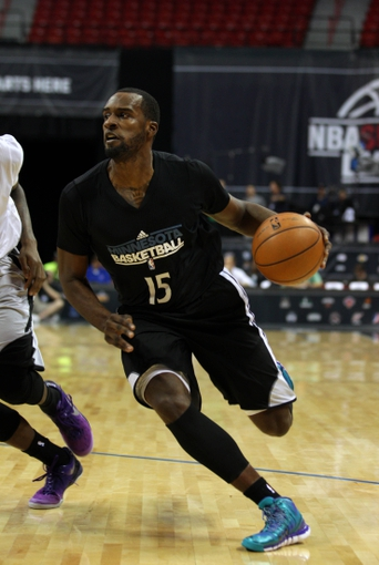 Jul 15, 2013; Las Vegas, NV, USA; Minnesota Timberwolves forward Shabazz Muhammad dribbles the ball towards the basket during an NBA Summer League game against the Phoenix Suns at the Thomas and Mack Center. Mandatory Credit: Stephen R. Sylvanie-USA TODAY Sports