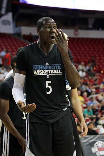 Jul 15, 2013; Las Vegas, NV, USA; Minnesota Timberwolves center Gorgui Deng reacts after a foul is called against him during an NBA Summer League game against the Phoenix Suns at the Thomas and Mack Center. Mandatory Credit: Stephen R. Sylvanie-USA TODAY Sports