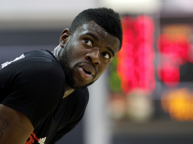 Jul 15, 2013; Las Vegas, NV, USA; Los Angeles Clippers shooting guard Reggie Bullock talks with a teammate during a Los Angeles Lakers free throw attempt during an NBA Summer League game at Cox Pavillion . Mandatory Credit: Stephen R. Sylvanie-USA TODAY Sports