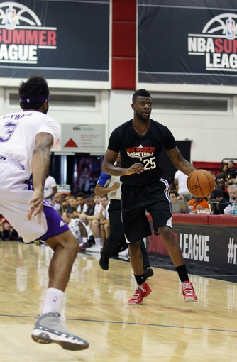 Jul 15, 2013; Las Vegas, NV, USA; Los Angeles Clippers shooting guard Reggie Bullock (25) dribbles the ball towards Los Angeles Lakers forward Lazar Hayward during an NBA Summer League game at Cox Pavillion. Mandatory Credit: Stephen R. Sylvanie-USA TODAY Sports