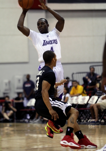 Jul 15, 2013; Las Vegas, NV, USA; Los Angeles Lakers guard Lester Hudson (4) passes the ball over Los Angeles Clippers point guard Jerome Randle during an NBA Summer League game at Cox Pavillion . Mandatory Credit: Stephen R. Sylvanie-USA TODAY Sports
