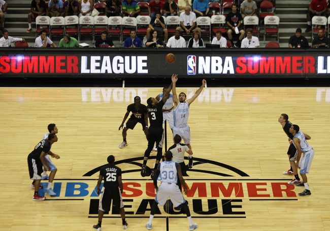Jul 15, 2013; Las Vegas, NV, USA; Chicago Bulls forward Malcolm Thomas (3) and Denver Nuggets center Kyle Barone (14) jump for the tip off to begin an NBA Summer League game at the Thomas and Mack Center. Mandatory Credit: Stephen R. Sylvanie-USA TODAY Sports