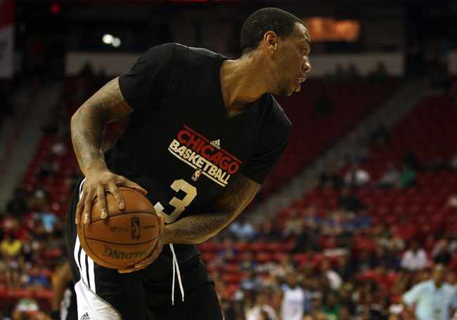 Jul 15, 2013; Las Vegas, NV, USA; Chicago Bulls forward Malcolm Thomas holds the ball away from a Denver Nuggets player during an NBA Summer League game at the Thomas and Mack Center. Mandatory Credit: Stephen R. Sylvanie-USA TODAY Sports