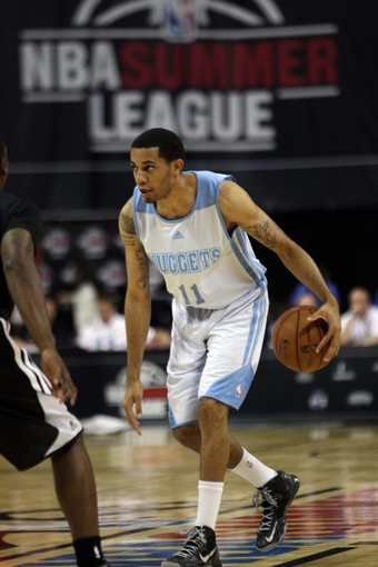 Jul 15, 2013; Las Vegas, NV, USA; Denver Nuggets guard Erick Green dribbles the ball across center court during an NBA Summer League game against the Chicago Bulls at the Thomas and Mack Center. Mandatory Credit: Stephen R. Sylvanie-USA TODAY Sports