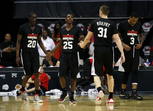 Jul 15, 2013; Las Vegas, NV, USA; Chicago Bulls guard Marquis Teague, center, is congratulated by Bulls guard Tony Snell, left, and forward Erik Murphy after Snell was a