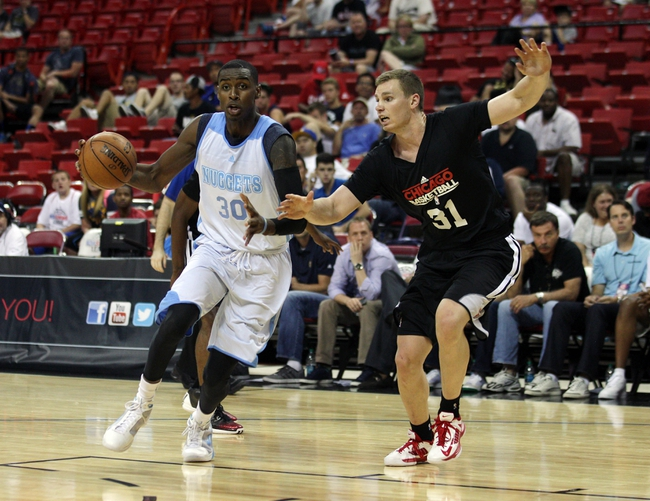 Jul 15, 2013; Las Vegas, NV, USA; Denver Nuggets forward Quincy Miller (30) drives the ball against the defense of Chicago Bulls forward Erik Murphy during the second half of an NBA Summer League game at the Thomas and Mack Center. Mandatory Credit: Stephen R. Sylvanie-USA TODAY Sports