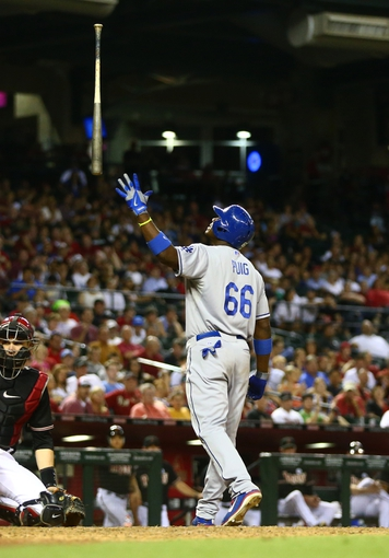Jul. 8, 2013; Phoenix, AZ, USA: Los Angeles Dodgers outfielder Yasiel Puig throws his bat in the air against the Arizona Diamondbacks at Chase Field. Mandatory Credit: Mark J. Rebilas-USA TODAY Sports