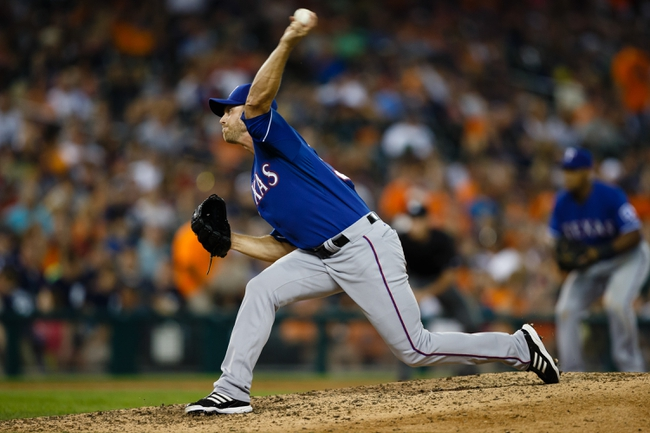 July 13, 2013; Detroit, MI, USA; Texas Rangers relief pitcher Neal Cotts (56) pitches in the ninth inning against the Detroit Tigers at Comerica Park. Texas won 7-1. Mandatory Credit: Rick Osentoski-USA TODAY Sports