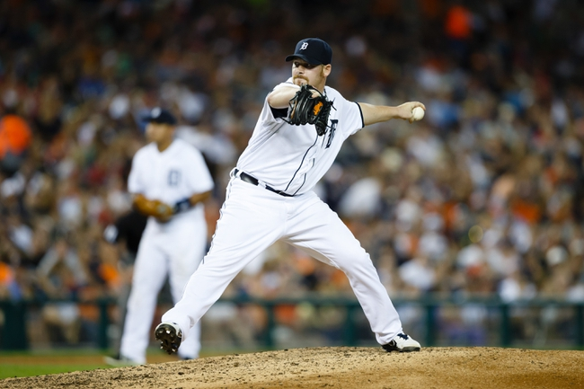July 13, 2013; Detroit, MI, USA; Detroit Tigers relief pitcher Phil Coke (40) pitches against the Texas Rangers at Comerica Park. Mandatory Credit: Rick Osentoski-USA TODAY Sports