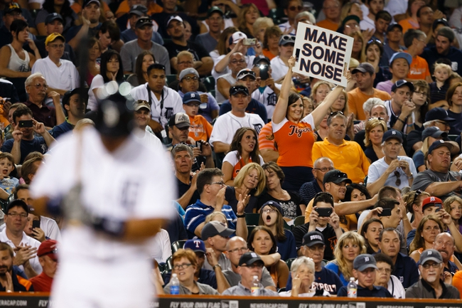 July 13, 2013; Detroit, MI, USA; Detroit Tigers Energy Squad member holds up a sign as third baseman Miguel Cabrera (24) gets set to bat against the Texas Rangers at Comerica Park. Mandatory Credit: Rick Osentoski-USA TODAY Sports