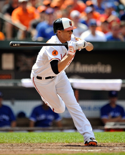 Jul 14, 2013; Baltimore, MD, USA; Baltimore Orioles third baseman Manny Machado (13) at bat in the seventh inning against the Toronto Blue Jays at Oriole Park at Camden Yards. The Orioles defeated the Blue Jays 7-4. Mandatory Credit: Joy R. Absalon-USA TODAY Sports