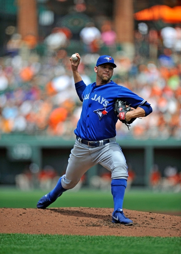 Jul 14, 2013; Baltimore, MD, USA; Toronto Blue Jays starting pitcher Josh Johnson (55) throws in the second inning against the Baltimore Orioles at Oriole Park at Camden Yards. The Orioles defeated the Blue Jays 7-4. Mandatory Credit: Joy R. Absalon-USA TODAY Sports