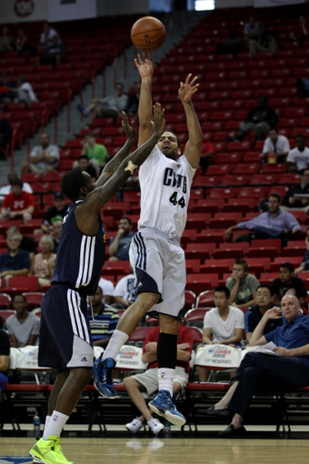 Jul 18, 2013; Las Vegas, NV, USA; Charlotte Bobcats forward Jeffery Taylor shoots over Memphis Grizzlies guard Tony Wroten during an NBA Summer League game at the Thomas and Mack Center. Mandatory Credit: Stephen R. Sylvanie-USA TODAY Sports