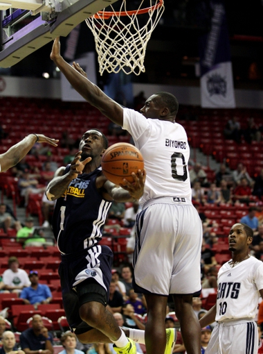 Jul 18, 2013; Las Vegas, NV, USA; Memphis Grizzlies guard Tony Wroten attempts to score on a hook around the defense of Charlotte Bobcats forward Bismack Biyombo during an NBA Summer League game at the Thomas and Mack. Mandatory Credit: Stephen R. Sylvanie-USA TODAY Sports