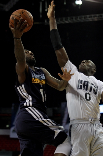 Jul 18, 2013; Las Vegas, NV, USA; Memphis Grizzlies forward Donte Green shoots a layup as Charlotte Bobcats forward Bismack Biyombo defends during an NBA Summer League game at the Thomas and Mack Center. Mandatory Credit: Stephen R. Sylvanie-USA TODAY Sports