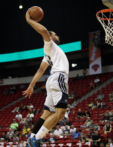 Jul 18, 2013; Las Vegas, NV, USA; Charlotte Bobcats forward Jeffrey Taylor dunks the ball against the Memphis Grizzlies during an NBA Summer League game at the Thomas and Mack Center. Mandatory Credit: Stephen R. Sylvanie-USA TODAY Sports