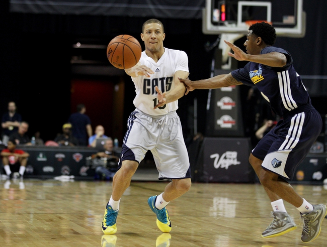 Jul 18, 2013; Las Vegas, NV, USA; Charlotte Bobcats guard Jerome Dyson passes the ball as Memphis Grizzlies guard Gerald Robinson defends during an NBA Summer League game at the Thomas and Mack Center. Charlotte won the game 92-84. Mandatory Credit: Stephen R. Sylvanie-USA TODAY Sports