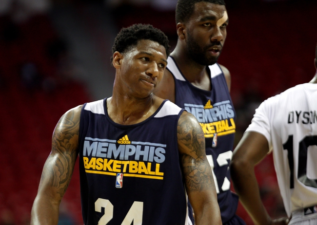 Jul 18, 2013; Las Vegas, NV, USA; A frustrated Memphis Grizzlies guard Gerald Robinson smirks after losing possession of the ball during an NBA Summer League game against the Charlotte Bobcats. Charlotte won the game 92-84. Mandatory Credit: Stephen R. Sylvanie-USA TODAY Sports