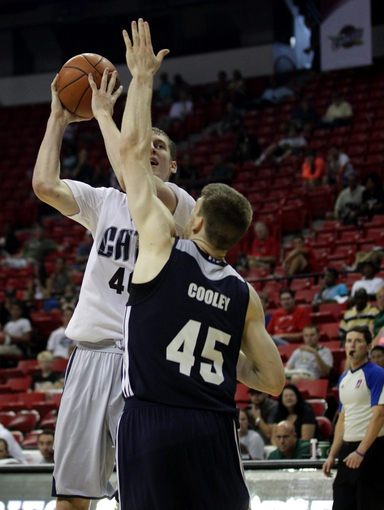 Jul 18, 2013; Las Vegas, NV, USA; Charlotte Bobcats center Cody Zeller keeps the ball from the reach of Memphis Grizzlies forward Jack Cooley during an NBA Summer League game at the Thomas and Mack Center. Charlotte won the game 92-84. Mandatory Credit: Stephen R. Sylvanie-USA TODAY Sports