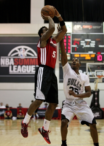 Jul 18, 2013; Las Vegas, NV, USA; Miami Heat guard Tony Taylor takes a jump shot over defending Chicago Bulls guard Marquis Teague during an NBA Summer League game at Cox Pavillion. Mandatory Credit: Stephen R. Sylvanie-USA TODAY Sports