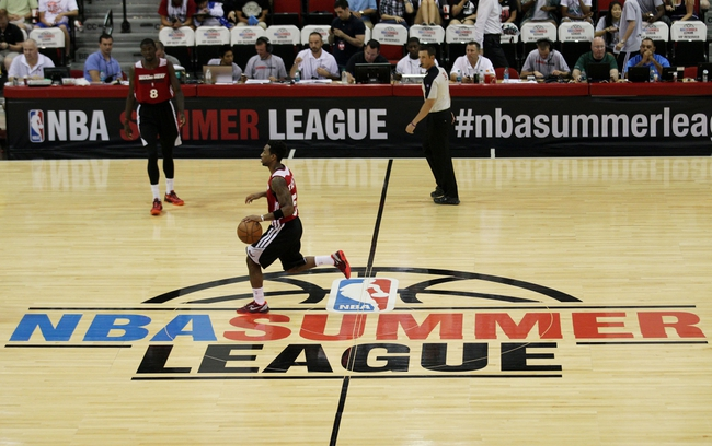 Jul 18, 2013; Las Vegas, NV, USA; Miami Heat guard Tony Taylor dribbles the ball through center court as the first quarter of play begins against the Chicago Bulls during an NBA Summer League game at Cox Pavillion. Mandatory Credit: Stephen R. Sylvanie-USA TODAY Sports