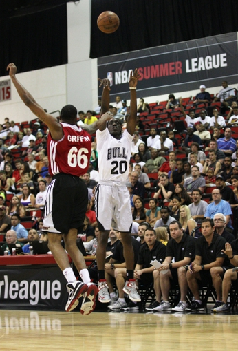 Jul 18, 2013; Las Vegas, NV, USA; Chicago Bulls guard Tony Snell takes a jump shot in front of defending Miami Heat forward Eric Griffin during an NBA Summer League game at Cox Pavillion. Mandatory Credit: Stephen R. Sylvanie-USA TODAY Sports
