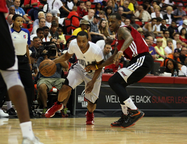 Jul 18, 2013; Las Vegas, NV, USA; Chicago Bulls guard Andrew Goudelock dribbles around Miami Heat guard James Nunnally during an NBA Summer League game at Cox Pavillion . Mandatory Credit: Stephen R. Sylvanie-USA TODAY Sports