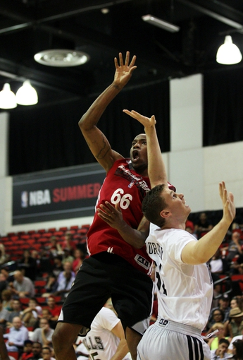 Jul 18, 2013; Las Vegas, NV, USA; Miami Heat forward Eric Griffin reacts after a shot misses while being defended against by Chicago Bulls forward Erik Murphy during an NBA Summer League game at Cox Pavillion.  The Heat won the game 68-62. Mandatory Credit: Stephen R. Sylvanie-USA TODAY Sports