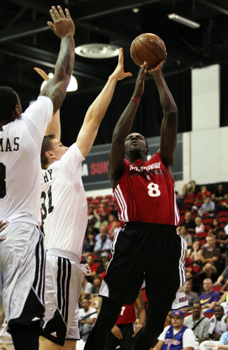 Jul 18, 2013; Las Vegas, NV, USA; Miami Heat guard James Ennis attempts a shot as Chicago Bulls forwards Malcolm Thomas, left, and Erik Murphy defend during an NBA Summer League game at Cox Pavillion.  The Heat won the game 68-62. Mandatory Credit: Stephen R. Sylvanie-USA TODAY Sports