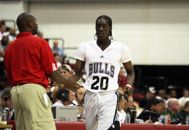 Jul 18, 2013; Las Vegas, NV, USA; Chicago Bulls guard Tony Snell is greeted back to the Chicago bench by assistant coach Adrian Griffinn during an NBA Summer League game against the Miami Heat at Cox Pavillion. The Heat won the game 68-62. Mandatory Credit: Stephen R. Sylvanie-USA TODAY Sports