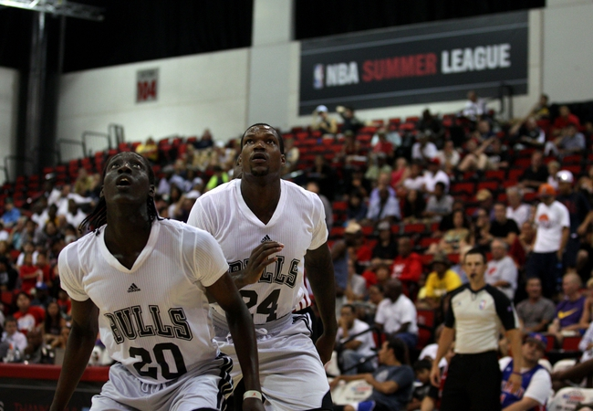 Jul 18, 2013; Las Vegas, NV, USA; Chicago Bulls guard Tony Snell and forward Deon Thompson look towards the basket as a free throw attempt is made by the Miami Heat during an NBA Summer League game at Cox Pavillion. The Heat won the game 68-62. Mandatory Credit: Stephen R. Sylvanie-USA TODAY Sports
