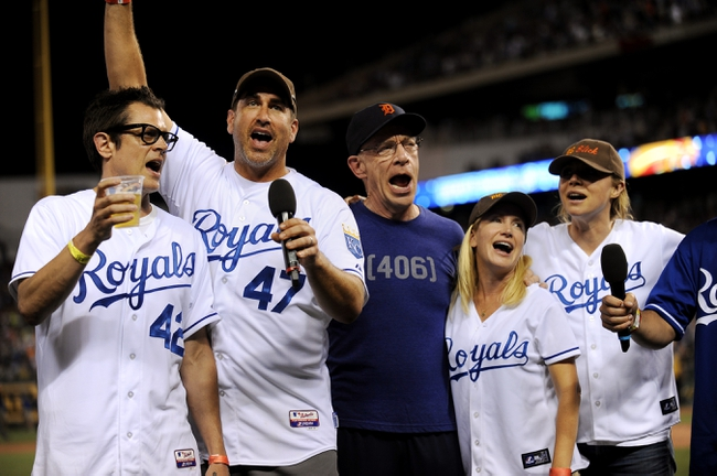"""Jul 19, 2013; Kansas City, MO, USA; Johnny Knoxville, Rob Riggle, J.K. Simmons, Angela Kinsey and Sarah Chalke (left to right) sing """"Take Me Out to the Ball Game"""" during the seventh inning of the game between the Kansas City Royals and Detroit Tigers at Kauffman Stadium. Mandatory Credit: Denny Medley-USA TODAY Sports"""