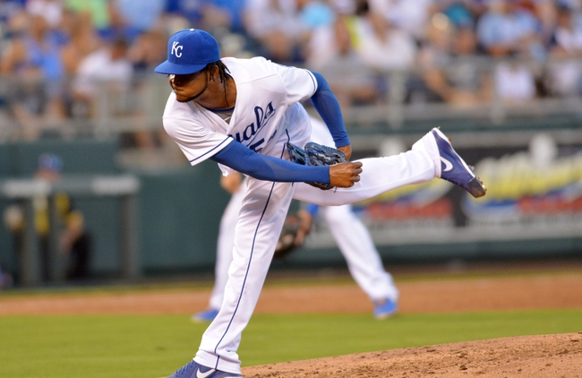 Jul 19, 2013; Kansas City, MO, USA; Kansas City Royals starting pitcher Ervin Santana (54) delivers a pitch in the fifth inning of the game against the Detroit Tigers at Kauffman Stadium. Mandatory Credit: Denny Medley-USA TODAY Sports