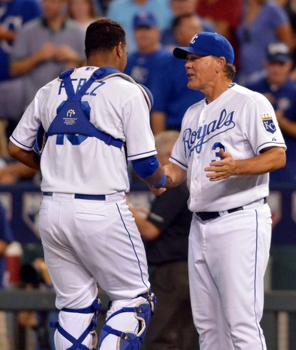 Jul 19, 2013; Kansas City, MO, USA; Kansas City Royals catcher Salvador Perez (13) is congratulated by manager Ned Yost (3) after the game against the Detroit Tigers at Kauffman Stadium. The Royals won 1-0. Mandatory Credit: Denny Medley-USA TODAY Sports