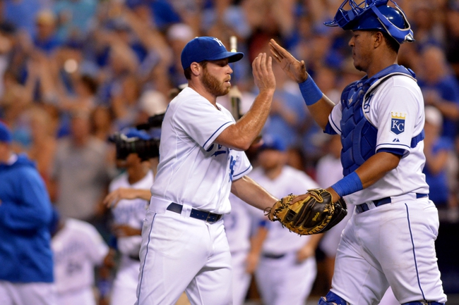 Jul 19, 2013; Kansas City, MO, USA; Kansas City Royals relief pitcher Greg Holland (56) is congratulated by catcher Salvador Perez (13) after the game against the Detroit Tigers at Kauffman Stadium. The Royals won 1-0. Mandatory Credit: Denny Medley-USA TODAY Sports