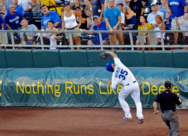 Jul 19, 2013; Kansas City, MO, USA; Kansas City Royals first baseman Eric Hosmer (35) fields a foul ball in the fourth inning of the game against the Detroit Tigers at Kauffman Stadium. The Royals won 1-0. Mandatory Credit: Denny Medley-USA TODAY Sports