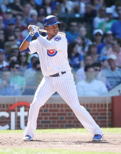Jul 12, 2013; Chicago, IL, USA; Chicago Cubs shortstop Starlin Castro at bat against the St. Louis Cardinals during the third inning at Wrigley Field. Mandatory Credit: Jerry Lai-USA TODAY Sports
