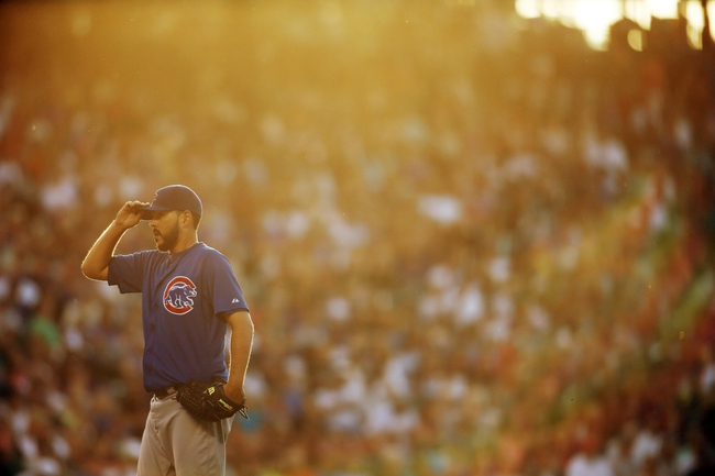 Jul 20, 2013; Denver, CO, USA; Chicago Cubs pitcher Carlos Villanueva (33) during the fourth inning against the Colorado Rockies at Coors Field. Mandatory Credit: Chris Humphreys-USA TODAY Sports