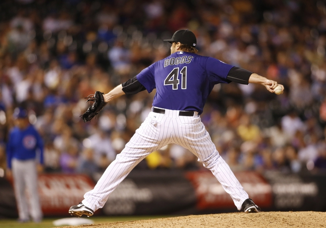 Jul 20, 2013; Denver, CO, USA; Colorado Rockies pitcher Mitchell Boggs (41) delivers a pitch during the eighth inning against the Chicago Cubs at Coors Field.  The Rockies won 9-3.  Mandatory Credit: Chris Humphreys-USA TODAY Sports