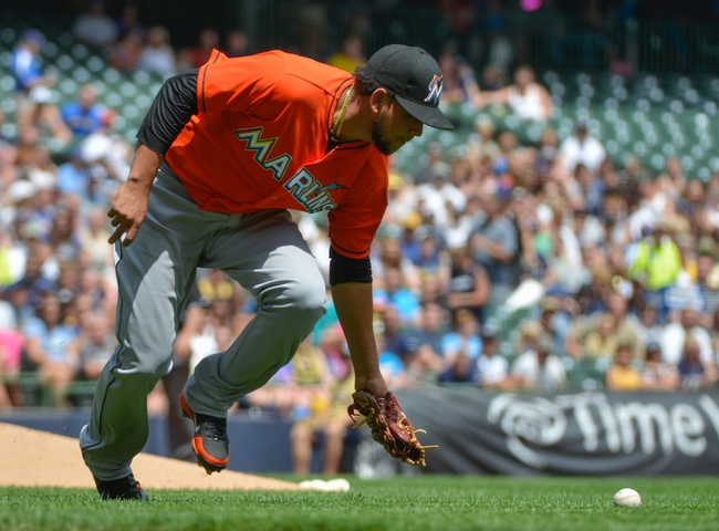 Jul 21, 2013; Milwaukee, WI, USA;  Miami Marlins pitcher Henderson Alvarez can't pick up a ball on a bunt hit by Milwaukee Brewers right fielder Norichika Aoki (not pictured) in the 3rd inning at Miller Park. Mandatory Credit: Benny Sieu-USA TODAY Sports