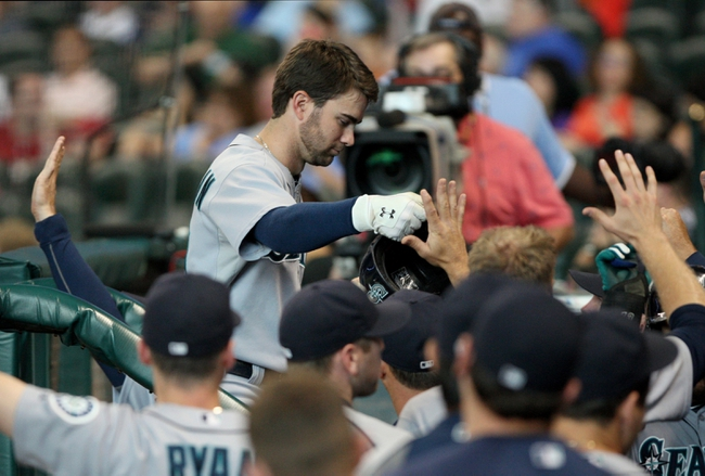 Jul 21, 2013; Houston, TX, USA; Seattle Mariners second baseman Nick Franklin (20) is congratulated after hitting a home run during the second inning against the Houston Astros at Minute Maid Park. Mandatory Credit: Troy Taormina-USA TODAY Sports