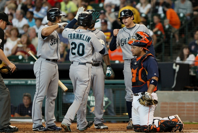 Jul 21, 2013; Houston, TX, USA; Seattle Mariners second baseman Nick Franklin (20) is congratulated by teammates after hitting a home run during the second inning against the Houston Astros at Minute Maid Park. Mandatory Credit: Troy Taormina-USA TODAY Sports