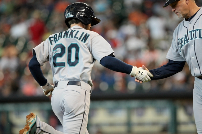 Jul 21, 2013; Houston, TX, USA; Seattle Mariners second baseman Nick Franklin (20) is congratulated by third base coach Jeff Datz (43) after hitting a home run during the second inning against the Houston Astros at Minute Maid Park. Mandatory Credit: Troy Taormina-USA TODAY Sports