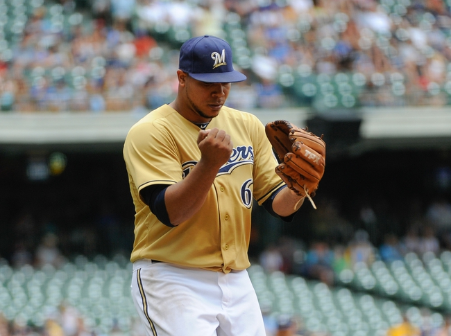 Jul 21, 2013; Milwaukee, WI, USA; Milwaukee Brewers pitcher Wily Peralta reacts after pitching the eighth inning against the Miami Marlins at Miller Park. Mandatory Credit: Benny Sieu-USA TODAY Sports